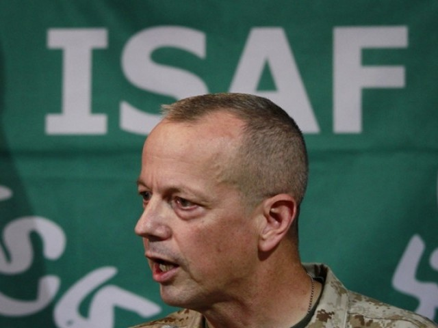 The US commander of Nato troops in Afghanistan apologised on Tuesday over reports that foreign troops had set fire to copies of the Holy Quran and ordered a full investigation into the allegations. PHOTO: AFP/FILE