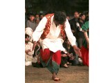 A dancer performs a traditional Punjabi folk dance. PHOTOS: FARHAN LASHARI/EXPRESS