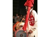 A drummer beats his 'dhol' during the Punjabi folk dance festival.  PHOTOS: FARHAN LASHARI/EXPRESS