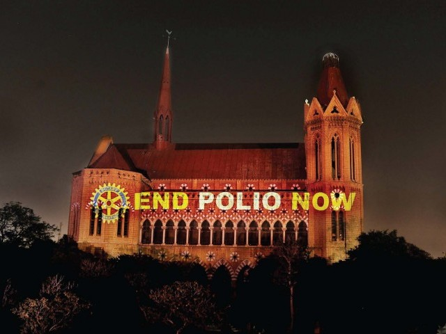 To help celebrate their 107th anniversary Thursday, Rotary International members across the world lit up landmarks to let their communities know about their work in the fight against polio. In this photo, Rotarians in Pakistan lit up Frere Hall in Karachi. Two children from Kashmore were diagnosed on Thursday. PHOTO: ROTARY INTERNATIONAL