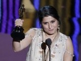 Daniel Junge and Sharmeen Obaid-Chinoy accept the Oscar for the Best Documentary Short Subject for their film 'Saving Face' at the 84th Academy Awards in Hollywood, California, February 26, 2012. PHOTO: REUTERS