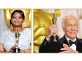 Veteran actor Christopher Plummer (R), and Octavia Spencer (L) pose with their Oscars. PHOTO: AFP