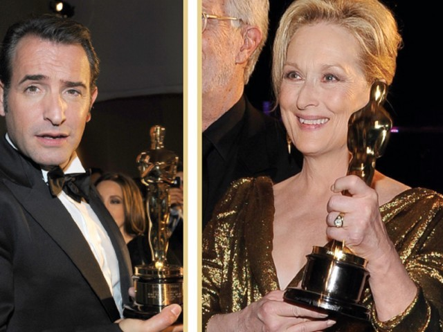 Top actors: Meryl Streep and Jean Dujardin hold aloft their Oscars. PHOTO: AFP