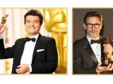 Michel Hazanavicius (R) and Thomas Langmann (L) pose with their Oscars of French silent film, 'The Artist'. PHOTO: AFP