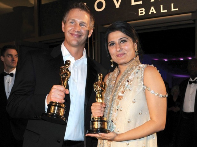 Daniel Jung and Sharmeen Obaid-Chinoy with the Oscar for  Best Documentary (short) for Saving Face. PHOTO: AFP