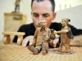 Cuban tobacco sculptor Janio Nunez adjusts one of his pieces made out of tobacco leaves, on February 27, 2012 at his workshop in Guanabo, a beach 25 km east of Havana. PHOTO: AFP