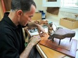 Cuban tobacco sculptor Janio Nunez works on his piano player sculpture made out of tobacco leaves, on February 27, 2012. PHOTO: AFP