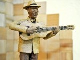"""Compay Segundo"" (world famous Cuban musician) made with tobacco leaves by Cuban tobacco sculptor Janio Nunez, on February 27, 2012 at his workshop in Guanabo, a beach 25 km east of Havana. PHOTO: AFP"