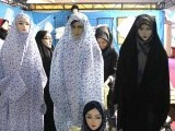 Iranian women work at the Islamic fashion exhibit in central Tehran on March 1, 2012. PHOTO: AFP