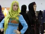 Mannequins covered with Islamic clothing designed by Iranian designers during an Islamic fashion exhibition in central Tehran March 1, 2012.
