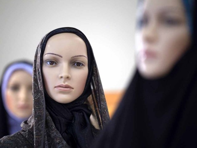 Mannequins covered with Islamic clothing designed by Iranian designers during an Islamic fashion exhibition in central Tehran March 1, 2012. PHOTO: REUTERS
