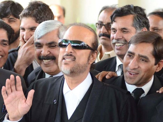 Showing solidarity, a large number of Awan's supporters in black coats attended the court proceedings. PHOTO: INP / FILE