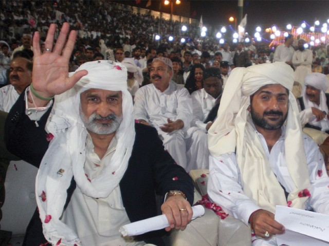 Zulfiqar Mirza and Uzair Baloch were showered with rose petals upon their arrival as Lyari celebrated Baloch Cultural Day at the stadium on Friday. PHOTO: ATHAR KHAN/EXPRESS