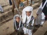 Two small boys turned up fully dressed in Baloch attire for the event. Lyari celebrated Baloch Cultural Day at the stadium on Friday. PHOTO: ATHAR KHAN/EXPRESS