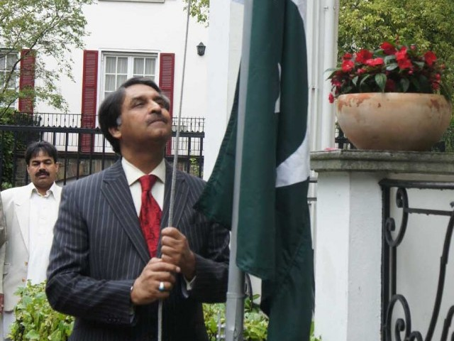 This August 2011 photo shows Pakistan's Ambassador to Belgium, Jalil Abbas Jilani hoisting the national flag at the Pakistani embassy in Belgium. He has been appointed as the Pakistan's Foreign Secretary. PHOTO: PID