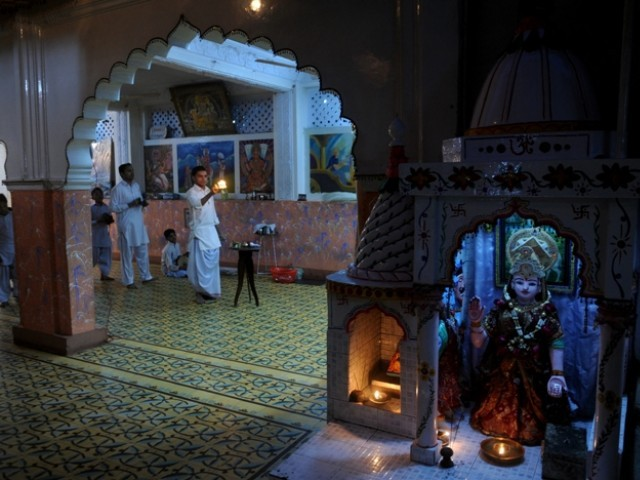 In this photograph taken on January 29, 2012, Hindu devotees worship at the Manher Mandir temple in Karachi. PHOTO: AFP