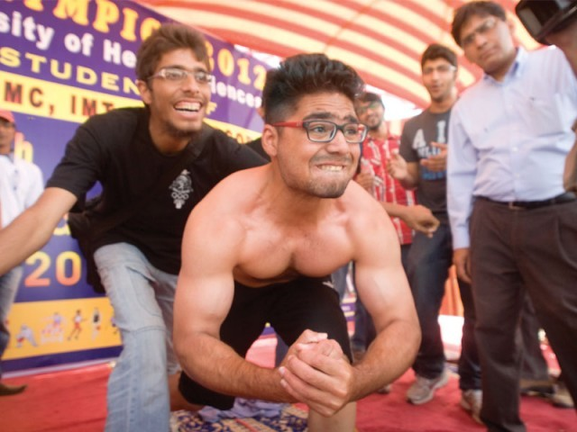 The body building competition stole the limelight on the first day of the Dow University of Health Sciences Olympics. PHOTO ATHAR KHAN/EXPRESS