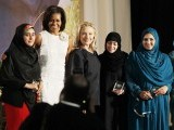 U.S. Secretary of State Hillary Clinton (3rd L) and First Lady Michelle Obama (2nd L) stand with four of the ten winners during the State Department's 2012 International Women of Courage Award winners ceremony.  in Washington March 8, 2012. From left, Maryam Durani of Afghanistan, Mrs. Obama, Mrs. Clinton, Samar Badawi of Saudi Arabia, Shad Begum of Pakistan, and Hawa Abdallah Mohammed Salih of Sudan. PHOTO: REUTERS
