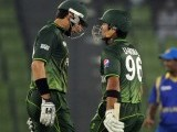 Pakistan's team captain Misbah-ul-Haq (L) talks to teammate Umar Akmal (R). PHOTO: AFP