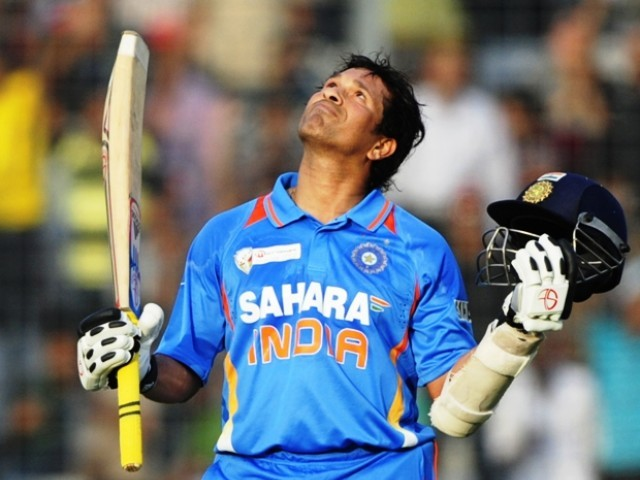 Indian batsman Sachin Tendulkar reacts after scoring his hundred century during the one day international (ODI) Asia Cup cricket match between India and Bangladesh at the Sher-e-Bangla National Cricket Stadium in Dhaka on March 16, 2012.  PHOTO: AFP