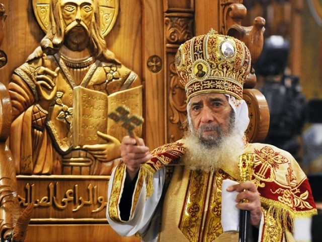 FIle picture dated January 7, 2010 shows Pope Shenuda III, the head of the Egyptian Coptic Orthodox church, celebrating Christmas midnight mass at the Al-Abbassiya catherdral in Cairo. PHOTO: AFP