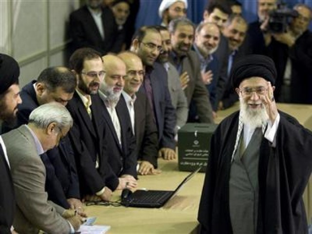 Iran's Supreme Leader Ayatollah Ali Khamenei waves to the media after presenting his identification papers to cast his ballot in the parliamentary election in Tehran March 2, 2012. PHOTO: REUTERS