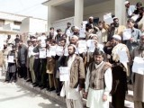 people protesting against non-payment of grants in Swat. PHOTO: THE EXPRESS TRIBUNE