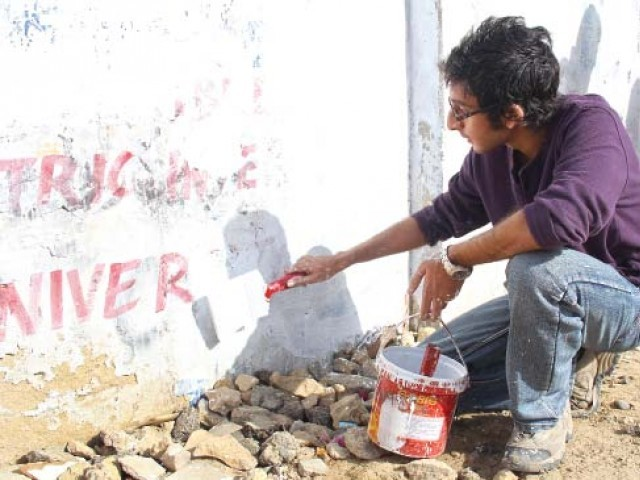 Numerous young people were found on the main Zamzama road, participating in an anti wall-chalking drive that was organised by Let's Build On and Green Volunteers Pakistan on Friday. PHOTO: AYESHA MIR/ EXPRESS