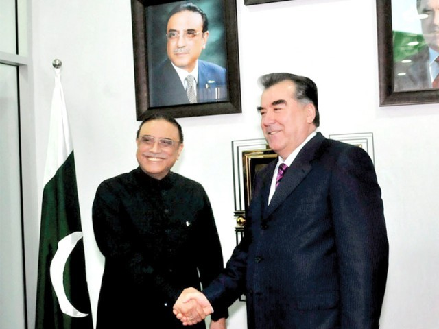 President Asif Ali Zardari shaking hands with Tajik President Emomali Rahmon. PHOTO: APP