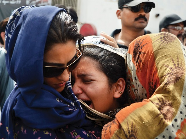 Nadia Gabol comforts a relative. PHOTO: ATHAR KHAN/EXPRESS