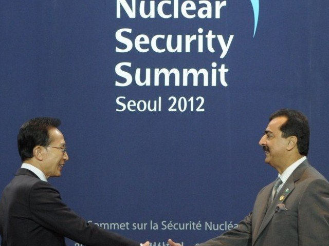 South Korea's President Lee Myung-Bak (L) greets Pakistan's Prime Minister Yousuf Raza Gilani as he arrives for the welcoming ceremony for the 2012 Seoul Nuclear Security Summit at the Coex Center in Seoul on March 26, 2012.  The two-day meeting in South Korea is a follow-up to an inaugural summit in Washington in 2010 hosted by US President Barack Obama, which kick-started efforts to lock up fissile material around the globe that could make thousands of bombs. PHOTO: AFP