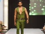 A Pakistani model presents a creation by Zaheer Abbas during a fashion show in Karachi on March 26, 2012.