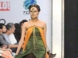 A Pakistani model presents a creation by Zaheer Abbas during a fashion show in Karachi on March 26, 2012. PHOTO : AFP