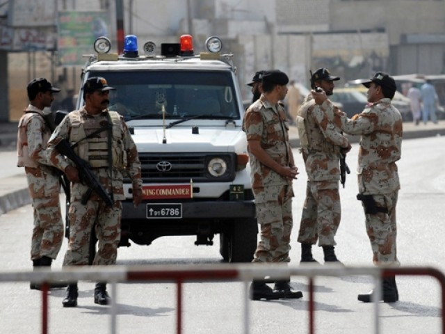 Police, rangers and FC surround Kati Pahari, Qasba Colony, 1C area and Bukhari Colony, arrest 12. PHOTO: AFP/FILE