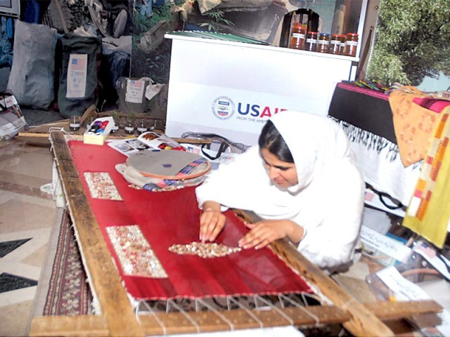 A woman from Malakand displaying her skills at the USAID seminar held in Islamabad on MONDAY. PHOTO: SANA