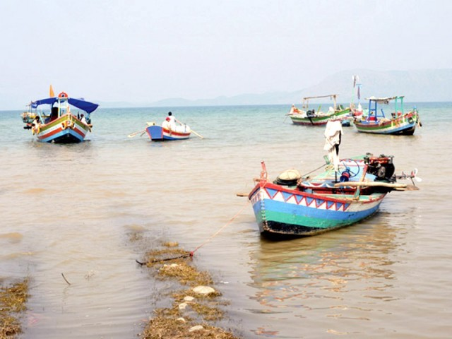 Boats ferrying across Tarbela Lake do not have any safety equipment on board, endangering passengers' lives. PHOTO: FILE
