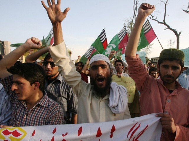 File photo shows ASWJ activists raising slogans during a demonstration for Gilgit shooting victims in Islamabad on April 3, 2012. PHOTO: AFP/FILE