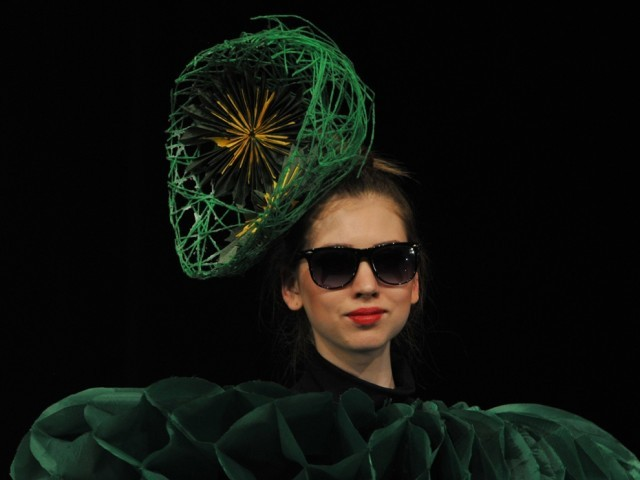 A model displays a creation by a group of Kyrgyz designers 'NAH' during a Fashion Week in Bishkek, on April 4 2012. PHOTO: AFP
