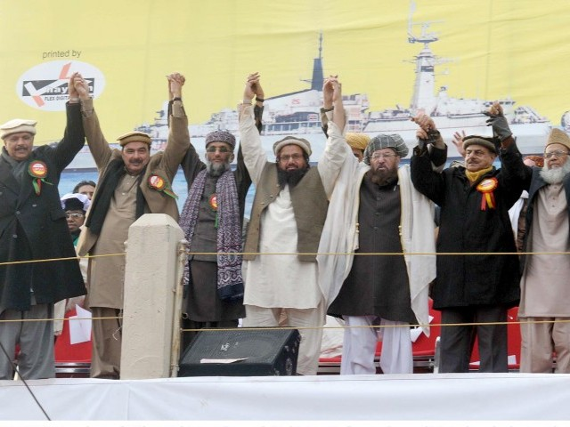 Leaders of Difa-i-Pakistan Council join hands during a rally at Liaqat Bagh in Rawalpindi on January 22, 2012. PHOTO: INP/FILE