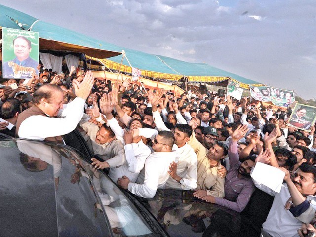 PML-N Chief Muhammad Nawaz Sharif waves at the crowd before leaving the convention venue. PHOTO: INP