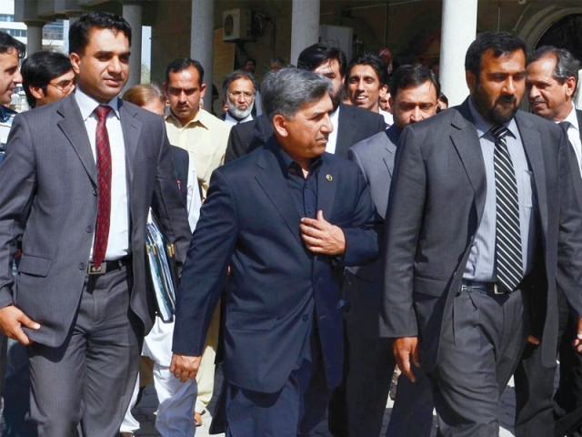 Former ISI chief Ahmad Shuja Pasha leaves the hearing of the memo case at the Islamabad High Court. PHOTO: NNI