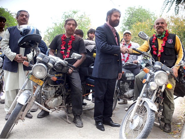 The motorcyclists being received on their arrival. PHOTO: QAZI USMAN/EXPRESS