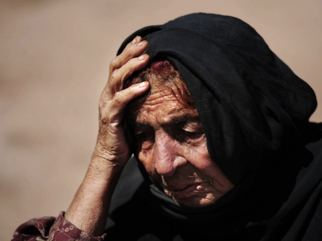 An  internally displaced elderly woman waiting for relief goods in Pakistan's largest refugee camp, Jalozai, about 35 kms outside Peshawar. PHOTO: AFP