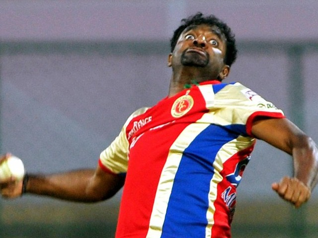 Royal Challengers Bangalore bowler Muttiah Muralitharan delivers a ball during the IPL Twenty20 cricket match. PHOTO: AFP