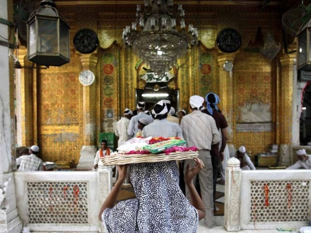 A girl carries a basket of offerings on her head to the shrine of Sufi saint Khwaja Moinuddin Chishti. PHOTO: REUTERS