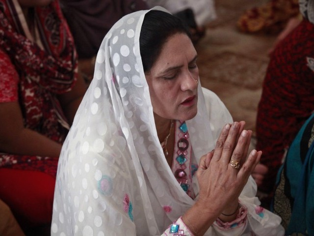 A Pakistani Christian prays while attending Easter celebrations at the Cathedral of the Sacred Heart of Jesus in Lahore. PHOTO: REUTERS