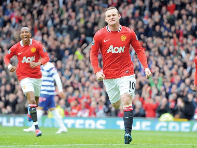 Wayne Rooney scored his 30th goal of the season as United recorded a 2-0 win over QPR before City suffered a 1-0 loss to Arsenal. PHOTO: AFP