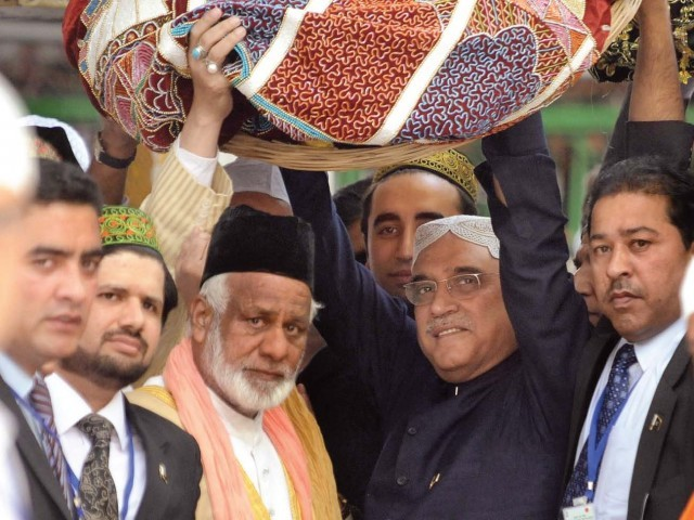President Zardari carries a traditional offering at the Ajmer shrine. PHOTO: AFP