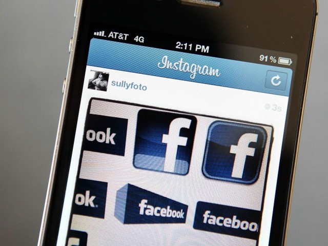 In this photo illustration, an Instagram photo of various Facebook logos are seen on an Apple iPhone on April 9, 2012 in New York City. Facebook Inc. is acquiring photo-sharing app Instagram for approx. $1 billion. PHOTO: AFP
