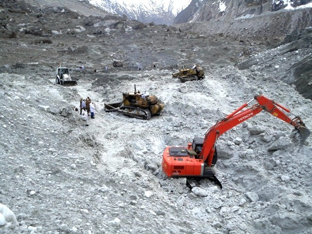 Handout photograph taken on April 9, 2012, and released by Inter Services Public Relations (ISPR), shows heavy machinery being used to search for avalanche victims. PHOTO: ISPR